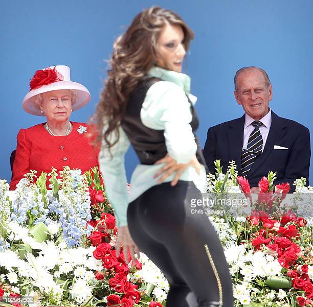 Queen Elizabeth II and Prince Philip Duke of Edinburgh watch a dancer perform during Canada Day celebrations on Parliament Hill on July 1 2010 in...