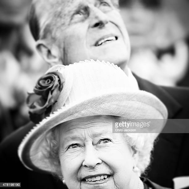 Queen Elizabeth II and Prince Philip Duke of Edinburgh watch a fly past after arriving at Tegel airport on the first of their fourday visit to...
