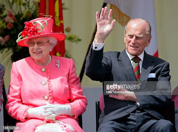 Queen Elizabeth II and Prince Philip Duke of Edinburgh watch the Shropshire Diamond Jubilee Pageant during a visit to RAF Cosford as part of Queen...