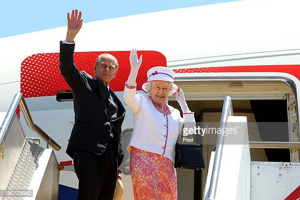 Queen Elizabeth II and Prince Philip Duke of Edinburgh wave farewell to Australia at the Perth International Airport on October 29 2011 in Perth...