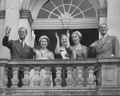Queen Elizabeth II and Prince Philip Duke of Edinburgh wave from the balcony of the Eremitageslottet with members of the Danish Royal family Princess...