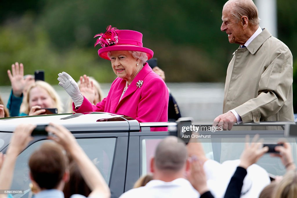 Queen Elizabeth II and Prince Philip, Duke of Edinburgh wave to guests during 'The Patron's Lunch' celebrations for The Queen's 90th birthday at on June 12, 2016 in London, England.