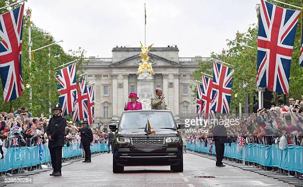 Queen Elizabeth II and Prince Philip Duke of Edinburgh wave to guests attending 'The Patron's Lunch' celebrations for The Queen's 90th birthday on...
