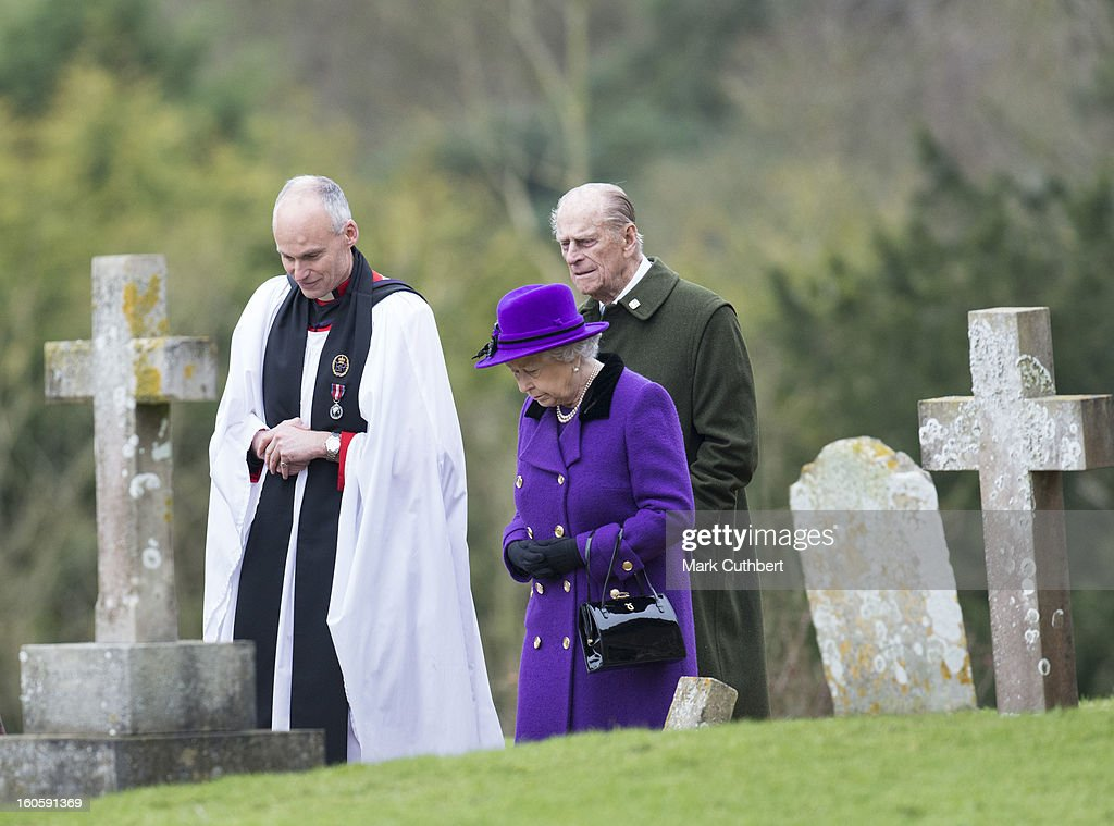 Queen Elizabeth II and Prince Philip, Duke of Edinburgh with Reverend Jonathan Riviere attend a service at the Church Of St Peter And St Paul in West Newton near Sandringham on February 3, 2013 near King's Lynn, England.
