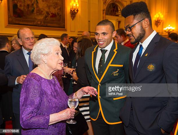 Queen Elizabeth II and Prince Philip Duke of Edinburgh with South Africa's Bryan Habana and Australia's Henry Speight at a Rugby World Cup reception...