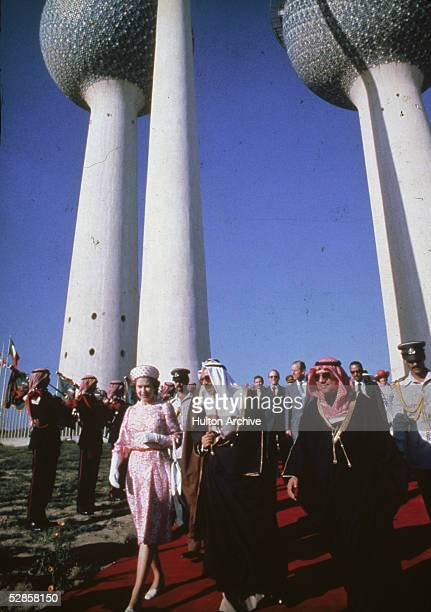 Queen Elizabeth II and Prince Philip Duke of Edinburgh with the Kuwaiti defence minister Salem Sabah beneath the newlybuilt Kuwait Towers 1979