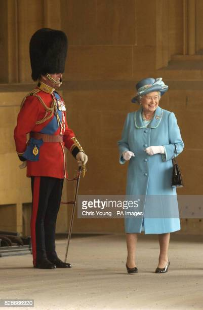 Queen Elizabeth II and Prince Philip enjoy the spectacle as a swarm of bees cause concern prior to The Queens Company Review at Windsor Castle The...