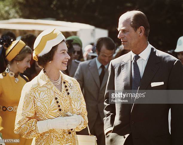 Queen Elizabeth II and Prince Philip in New Zealand during their Commonwealth Tour 1974 Behind them are Princess Anne and her husband Mark Phillips