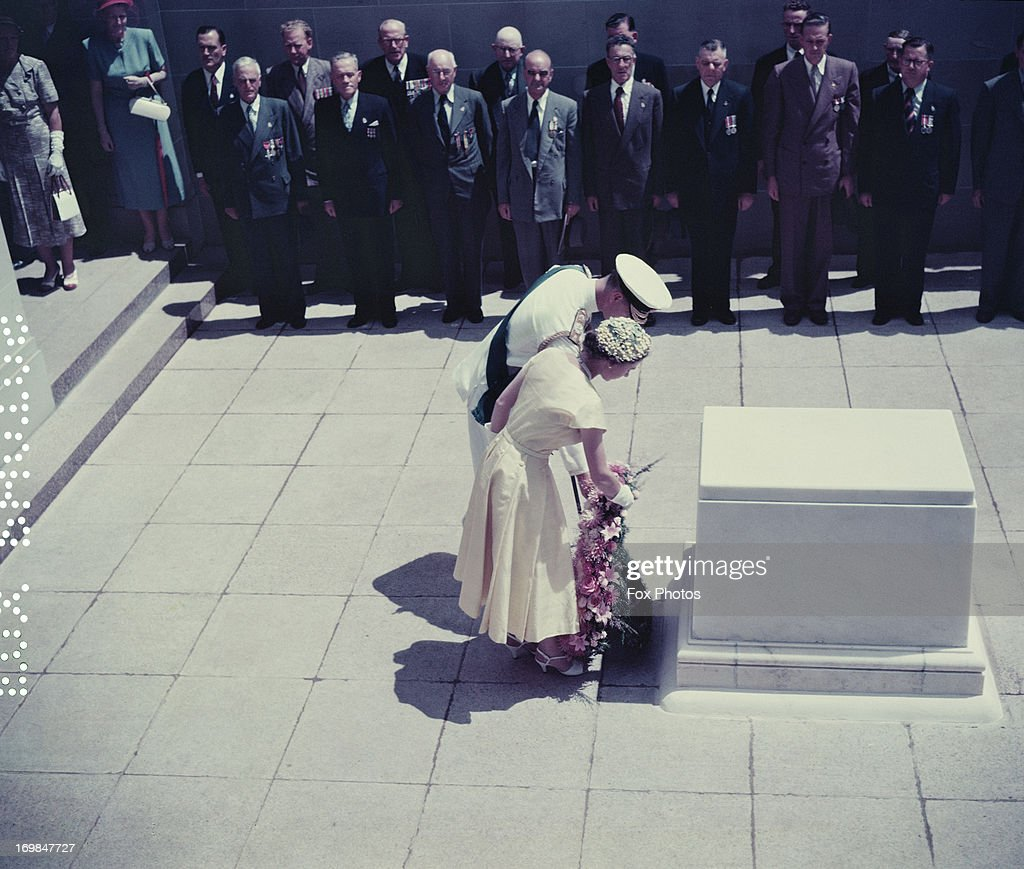 Queen Elizabeth II and Prince Philip lay a wreath on the Commemorative Stone at the Australian National War Memorial Canberra 1954