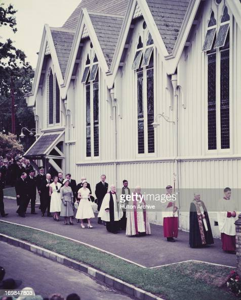 Queen Elizabeth II and Prince Philip leave Divine Service conducted by the Bishop of Auckland at St Mary's Cathedral Auckland New Zealand 1954