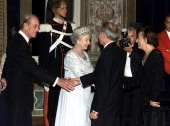Queen Elizabeth II and Prince Philip meet Italian Prime Minister Giuliano Amato and his wife Diana Vincenzi prior to a state banquet at the Quirinale...