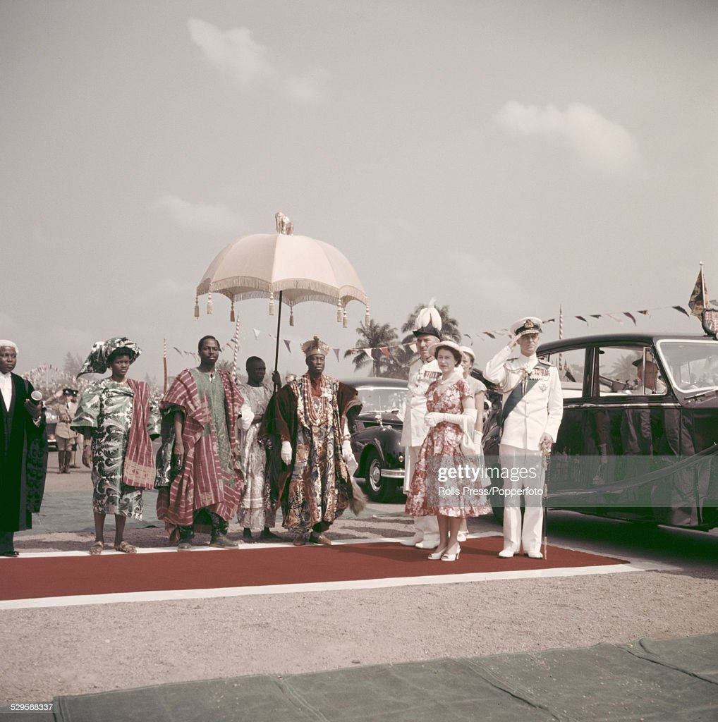 Queen Elizabeth II and Prince Philip Mountbatten Duke of Edinburgh pictured standing on a red carpet with Kwame Nkrumah President of Ghana during...
