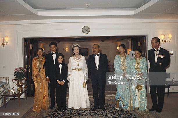 Queen Elizabeth II and Prince Philip posing with King Hassan II of Morocco and his family on board the Royal yacht Britannia moored in Casablanca...