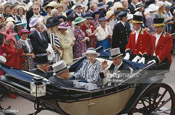 Queen Elizabeth II and Prince Philip riding in a horsedrawn carriage with US politician Henry Kissinger at the Royal Ascot race meeting at Ascot...