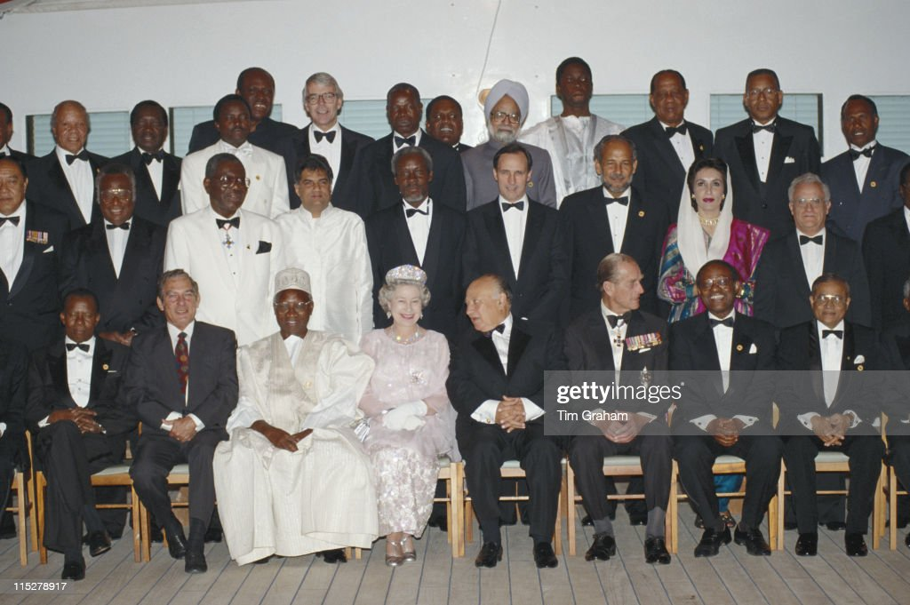 Queen Elizabeth II and Prince Philip sitting either side of the President of Cyprus, Glafcos Clerides, as they pose with various Commonwealth heads of government ahead of a banquet on board the Royal yacht Britannia, moored in Cyprus, 21 October 1993. Among the group is British Prime Minister John Major (back row) and Prime Minister of Pakistan, Benazir Bhutto (middle row).