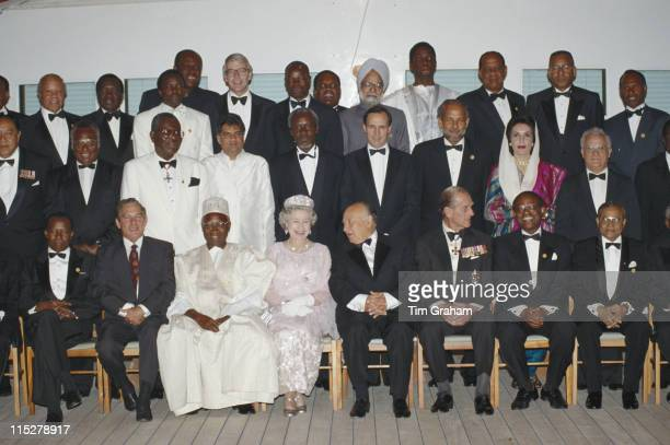 Queen Elizabeth II and Prince Philip sitting either side of the President of Cyprus Glafcos Clerides as they pose with various Commonwealth heads of...