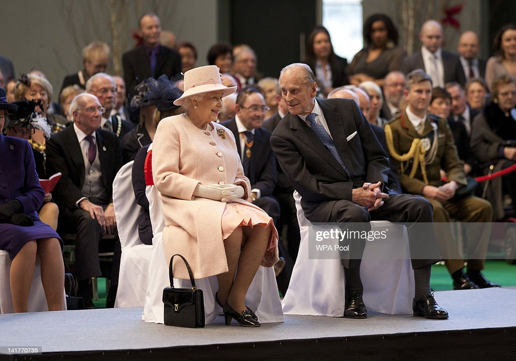 Queen <a gi-track='captionPersonalityLinkClicked' href=/galleries/search?phrase=Elizabeth+II&family=editorial&specificpeople=67226 ng-click='$event.stopPropagation()'>Elizabeth II</a> and <a gi-track='captionPersonalityLinkClicked' href=/galleries/search?phrase=Prince+Philip&family=editorial&specificpeople=92394 ng-click='$event.stopPropagation()'>Prince Philip</a>, the Duke of Edinburgh watch performers during a visit to the Manchester Central Convention Centre on March 23, 2012 in Manchester, England. The Queen and her husband, <a gi-track='captionPersonalityLinkClicked' href=/galleries/search?phrase=Prince+Philip&family=editorial&specificpeople=92394 ng-click='$event.stopPropagation()'>Prince Philip</a>, the Duke of Edinburgh visited Manchester where she officially opened hospitals, toured the new BBC building at MetroCity and officially started a Sport Relief Mile fun run.