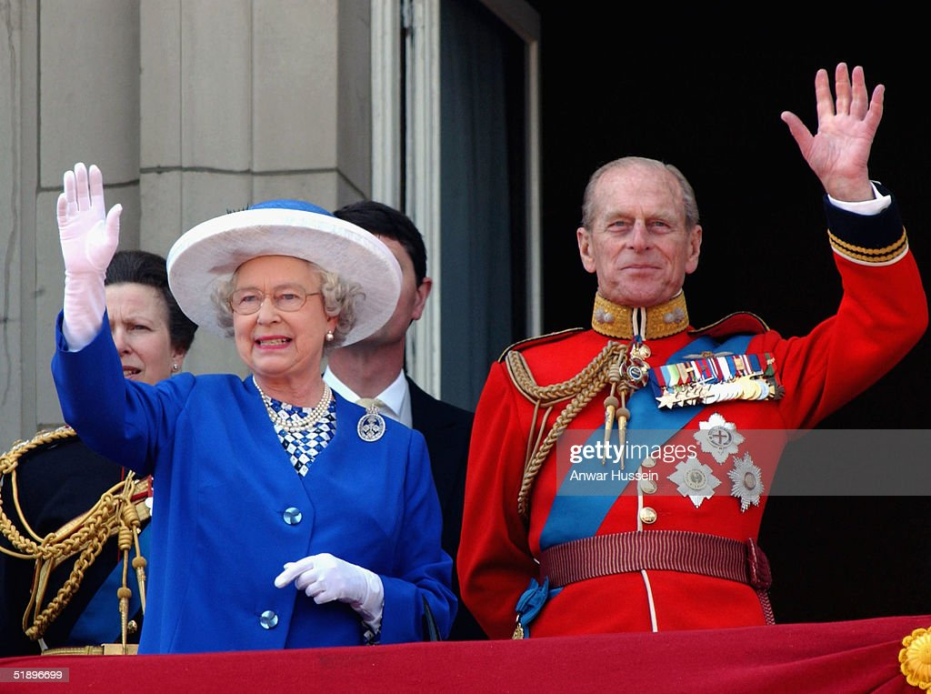 Queen Elizabeth II and Prince Philip, the Duke of Edinburgh wave from the balcony at Buckingham Palace after Trooping of the Colour in this June 14, 2003 file photo in London, England.