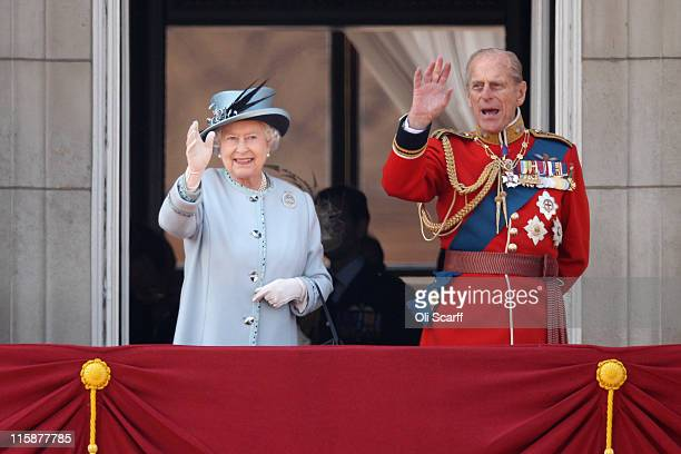 Queen Elizabeth II and Prince Philip the Duke of Edinburgh wave to the crowd as she celebrates her official birthday by taking part in the Trooping...