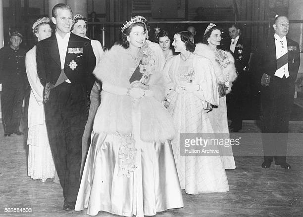 HM Queen Elizabeth II and Prince Philip the Duke of Edinburgh wearing formal dress as they attend a concert at Festival Hall London May 1951