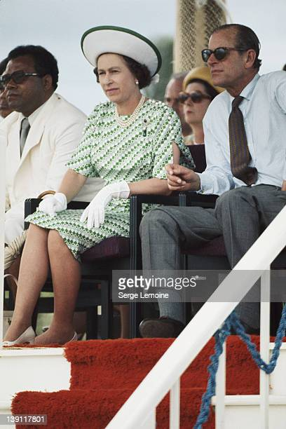 Queen Elizabeth II and Prince Philip watch the entertainments in Fiji during their royal tour February 1977