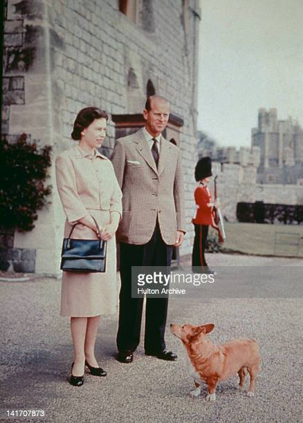 Queen Elizabeth II and Prince Philip with one of their corgis at Windsor Castle in Berkshire 1959