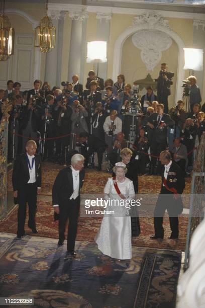 Queen Elizabeth II and Prince Philip with Richard von Weizsacker President of the Federal Republic of Germany at a banquet at the Schloss...