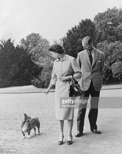 Queen Elizabeth II and Prince Philip with their corgi Sugar outside the George IV gateway at Windsor Castle 6th June 1959