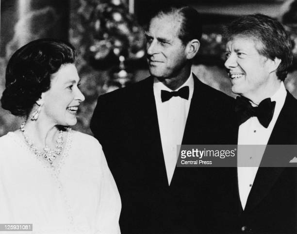 Queen Elizabeth II and Prince Philip with US President Jimmy Carter in the Blue Drawing Room at Buckingham Palace London 10th May 1977 Carter and...