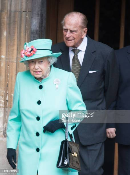 Queen Elizabeth II and Prince PhilipDuke of Edinburgh attend Easter Day Service at St George's Chapel on April 16 2017 in Windsor England
