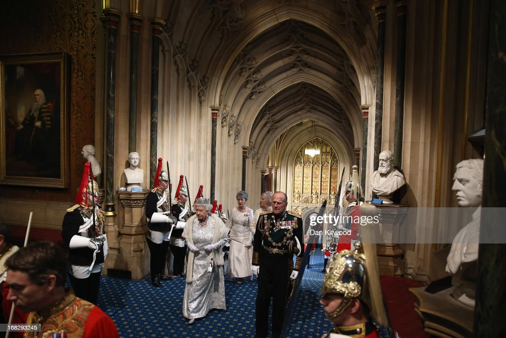 Queen Elizabeth II, and Prince Phillip, Duke of Edinburgh arrive ahead of the State Opening of Parliament on May 8, 2013 in London, England. Queen Elizabeth II unveiled the coalition government's legislative programme in a speech delivered to Members of Parliament and Peers in The House of Lords. Proposed legislation is expected to be introduced on toughening immigration regulations, capping social care costs in England and setting a single state pension rate of 144 GBP per week.