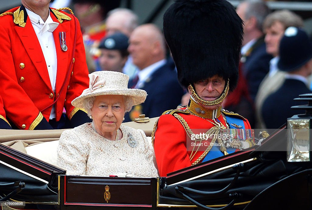 Queen Elizabeth II and Prince Phillip, Duke of Edinburgh arrive at Horseguards Parade during the annual Trooping The Colour ceremony at Horse Guards Parade on June 13, 2015 in London, England.