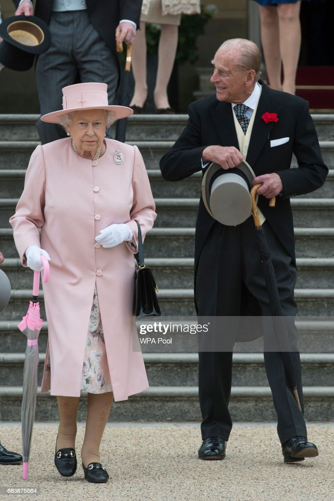 Queen Elizabeth II and Prince Phillip, Duke of Edinburgh at their garden party at Buckingham Palace on May 16, 2017 in London, England.