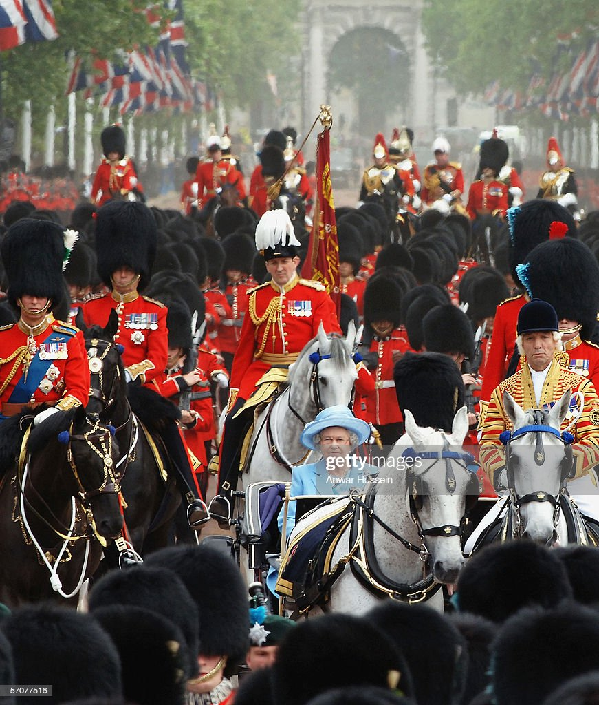 Queen Elizabeth II and Prince Phillip the Duke of Edinburgh leave Buckingham Palace by carriage for trooping of The Queen's Colour of First Battalion Grenadier Guards, marking The Queen's official birthday, at Horse Guards Parade on June 11, 2005 in London, England. It is The Queen's Colour of a Foot Guard battalion which is 'trooped' each year before the Sovereign, and this year is marked by the presence of Camilla, Duchess of Cornwall, for the first time.