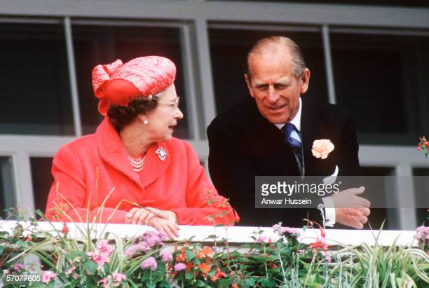Queen Elizabeth II and Prince Phillip the Duke of Edinburgh watch the action at the Epsom DerbyEpsomEngland on June the 7th 1989