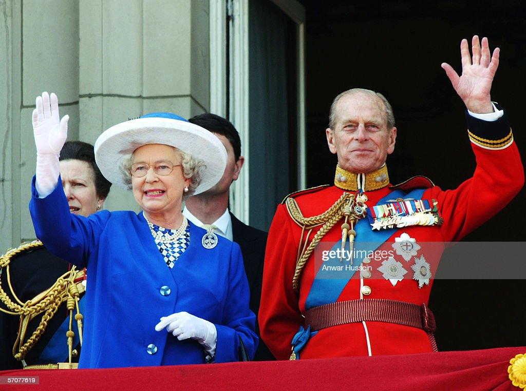 Queen Elizabeth II and Prince Phillip, the Duke of Edinburgh wave from the balcony at Buckingham Palace after Trooping of the Colour on June 14, 2003 in London, England.