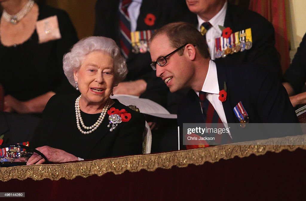Queen Elizabeth II and Prince William, Duke of Cambridge chat to each other in the Royal Box at the Royal Albert Hall during the Annual Festival of Remembrance on November 7, 2015 in London, England.
