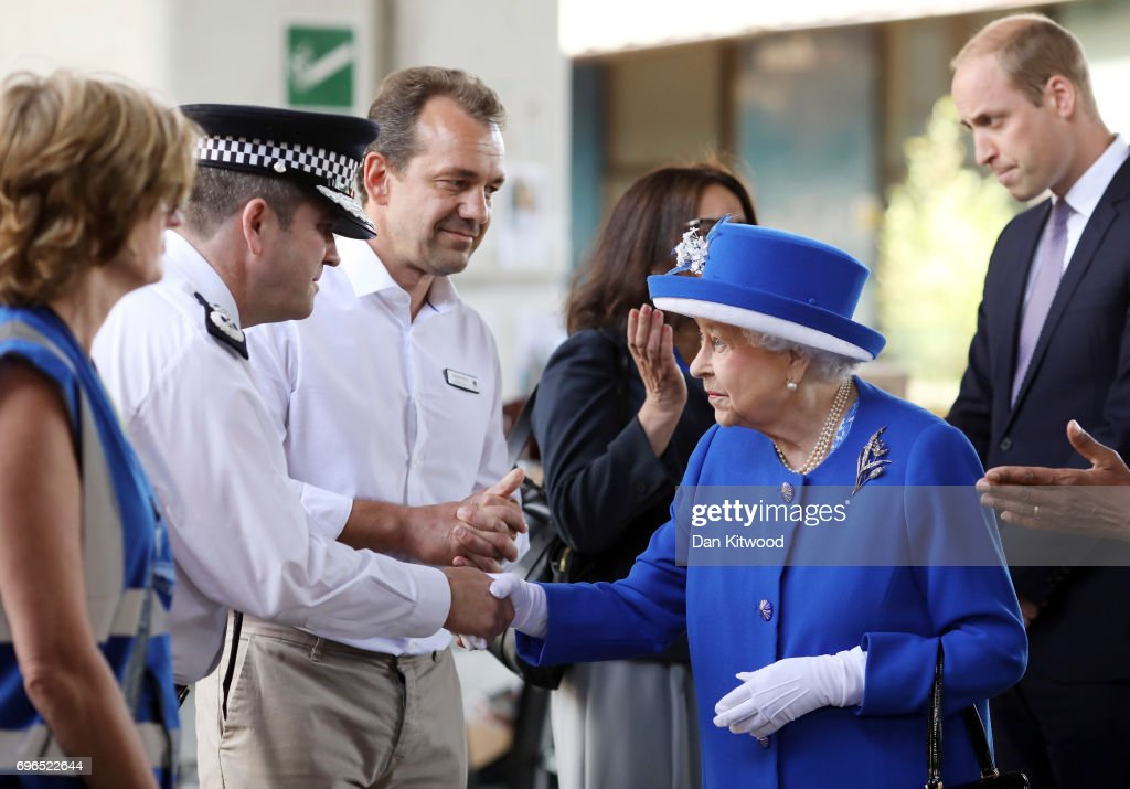 Queen Elizabeth II and Prince William, Duke of Cambridge (R) greet members of emergency services at the scene of the Grenfell Tower fire on June 16, 2017 in London, England. 17 people have been confirmed dead and dozens still missing, after the 24 storey residential Grenfell Tower block in Latimer Road was engulfed in flames in the early hours of June 14. Emergency services will spend a third day searching through the building for bodies. Police have said that some victims may never be identified.