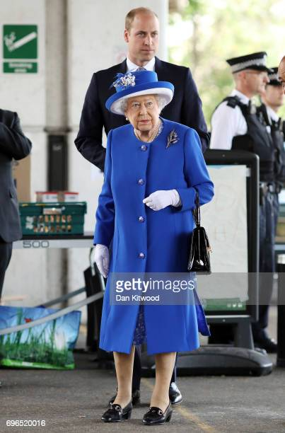 Queen Elizabeth II and Prince William Duke of Cambridge visit the scene of the Grenfell Tower fire on June 16 2017 in London England 17 people have...