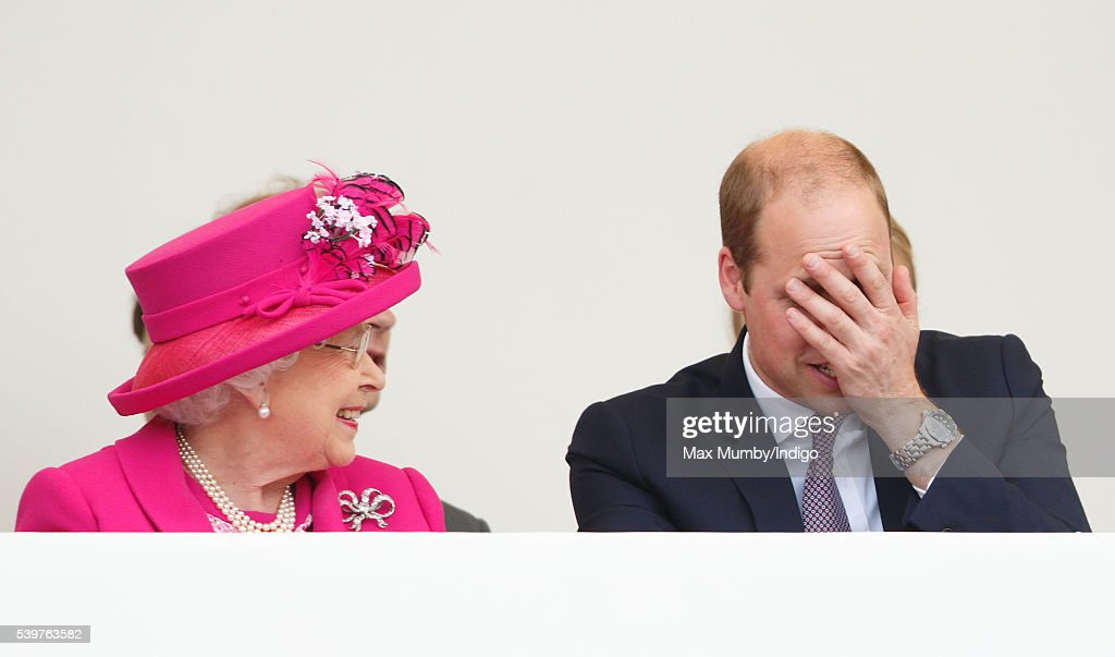 Queen Elizabeth II and Prince William, Duke of Cambridge watch a carnival parade as they attend 'The Patron's Lunch' celebrations to mark Queen Elizabeth II's 90th birthday on The Mall on June 12, 2016 in London, England.