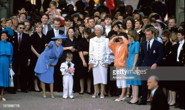 Queen Elizabeth II and Prince William surrounded by family and friends bid farewell to the Duke and Duchess of York as they set off on honeymoon...