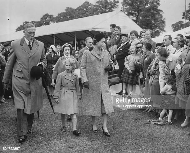 Queen Elizabeth II and Princess Anne followed by Princess Margaret arrive at the Royal Windsor Horse Show England May 11th 1957