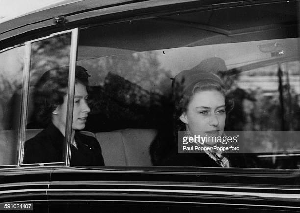 Queen Elizabeth II and Princess Margaret arrive by car at Buckingham Palace to take up residence following the death of King George VI London May 5th...