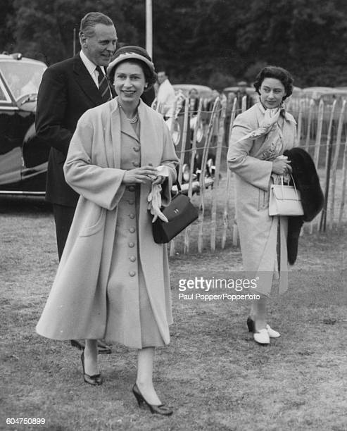 Queen Elizabeth II and Princess Margaret arrive to watch a polo match between Oxford and Cambridge Universities on Smiths Lawn in Windsor Great Park...