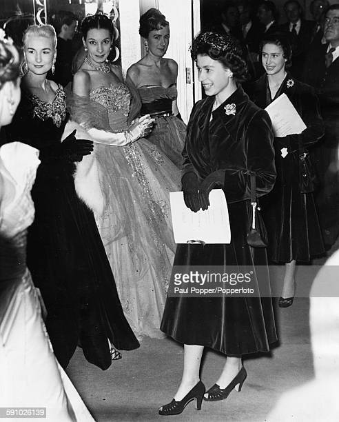 Queen Elizabeth II and Princess Margaret meet some of the models who took part in a fashion show at Claridges Hotel in London on November 12th 1952