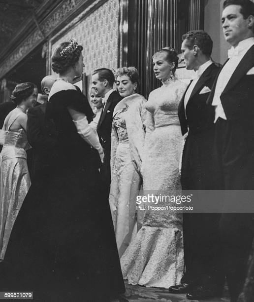 Queen Elizabeth II and Princess Margaret meets with film stars after the Royal Film performance of 'The Battle of the River Plate' John Gregson Peter...