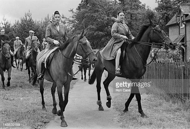 Queen Elizabeth II and Princess Margaret out riding at Ascot 20th June 1969 Antony ArmstrongJones 1st Earl of Snowdon is on the left in the background