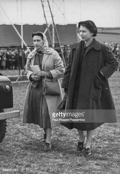 Queen Elizabeth II and Princess Margaret return to their Land Rover for the journey back to Sandringham after watching a pointtopoint race meeting at...