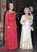 Queen Elizabeth II and Queen Margrethe of Denmark welcome guests at a reception hosted by the Danish Queen at The Natural History MuseumLondon on...