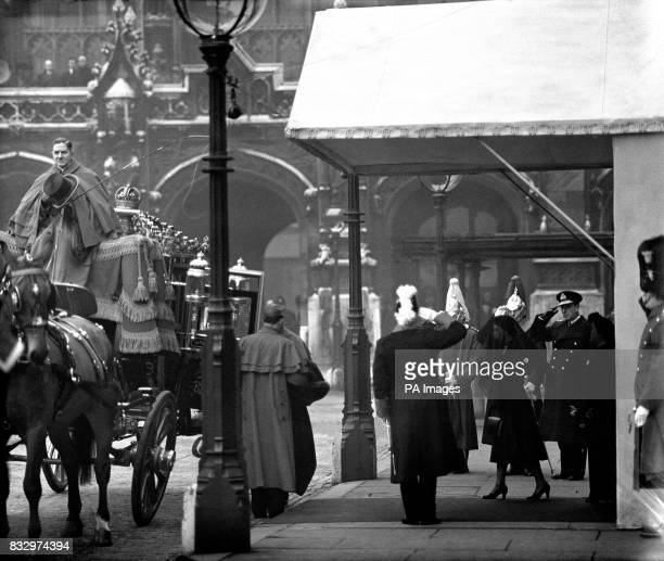 Queen Elizabeth II and Queen Mother are saluted as they walk to their carriage at Westminster Hall for the start of the funeral procession of King...